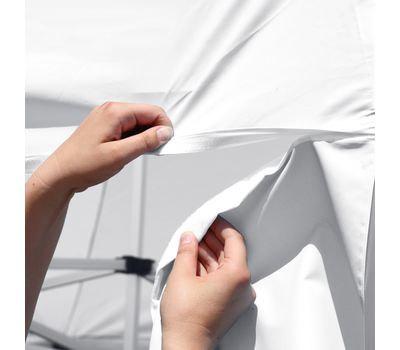 Walls attach to canopy using hook-and-loop adhesive.