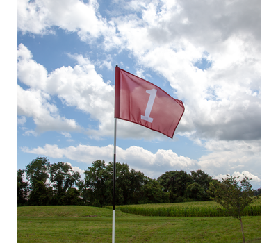 The golf flag spins freely in the wind.