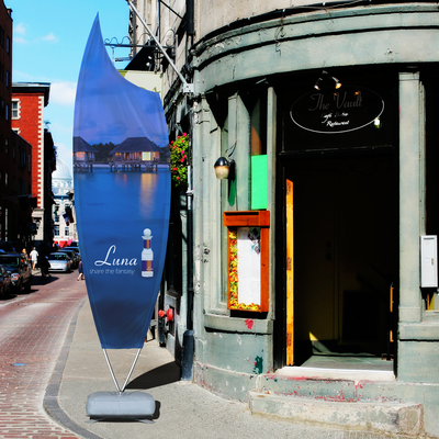 Your client's print features printed pole sleeves to increase advertising space