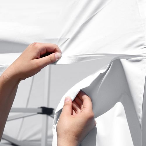 Walls attach to canopy using hook-and-loop fastener