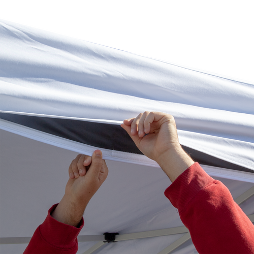 Canopy liner valances adhere to canopy valances with hook-and-loop fastener to provide a professional look